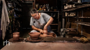Environmental portrait of Townsville Artist/Potter, Fiona Banner, at work in her studio