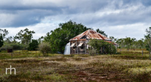 Landscape image of old abandoned house beside the Flinders Highway at Woodstock, Q, Australia